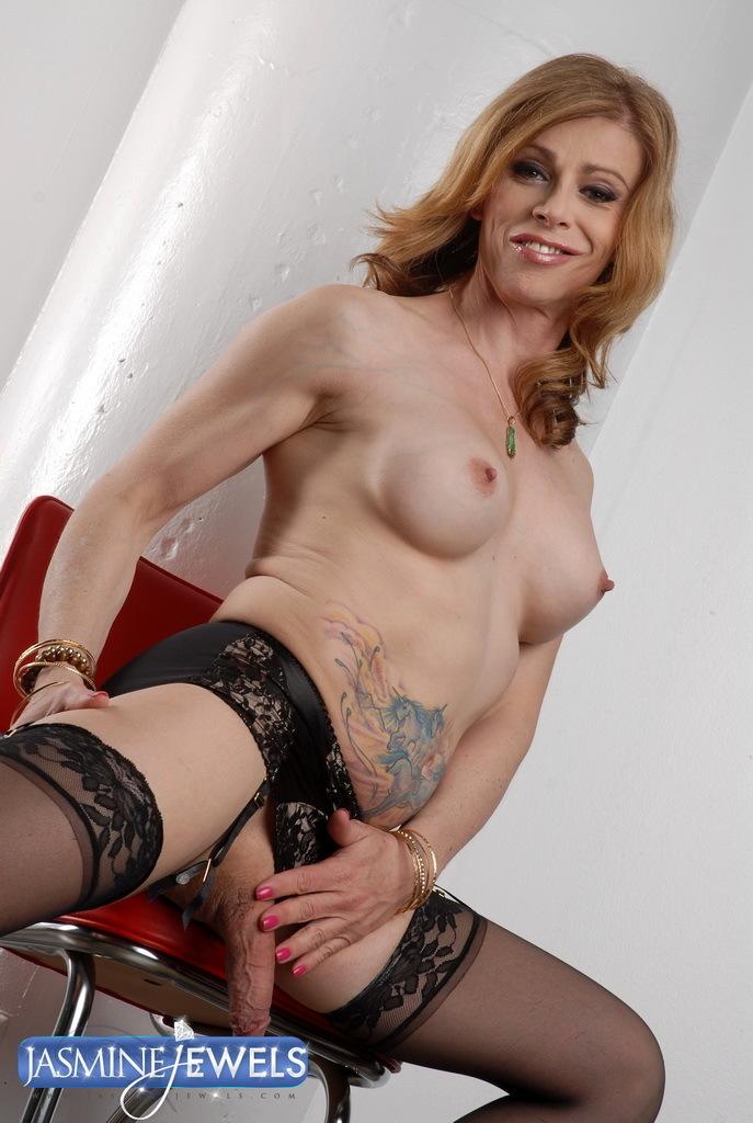 Sensuous Transsexual MILF Posing In Sexy Black Stockings