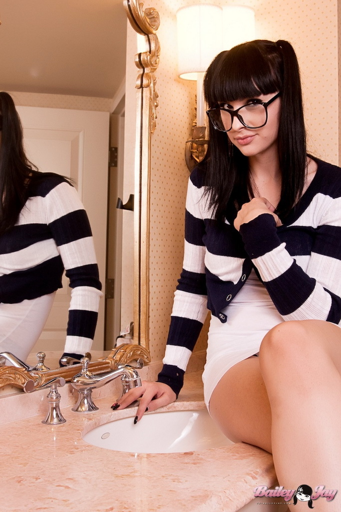 TS Sweetheart With Massive Glasses Posing In The Bathroom